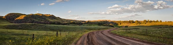 Panoramas/Wide View - color | Ranch Road, Northern Colorado - color. Fine art color photograph by David Zlotky. Pano. sunset over a ranch road in the foot hills.