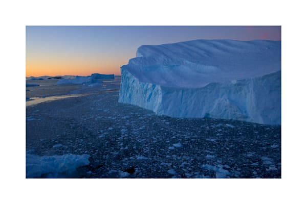 Photo of large iceberg in Cierva Cove, Antarctica, at dusk.