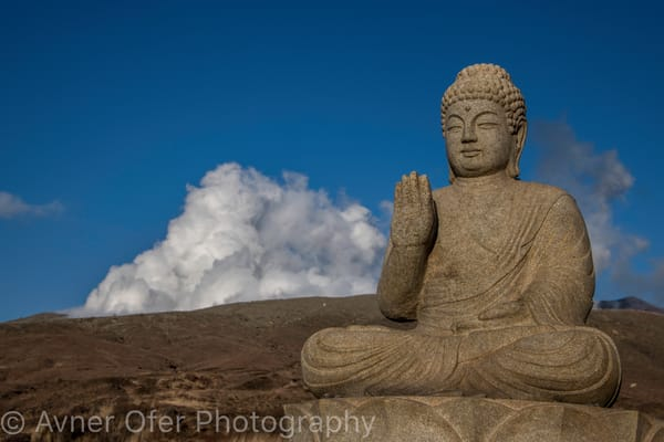 Buddha statue in front of Aso Volcano
