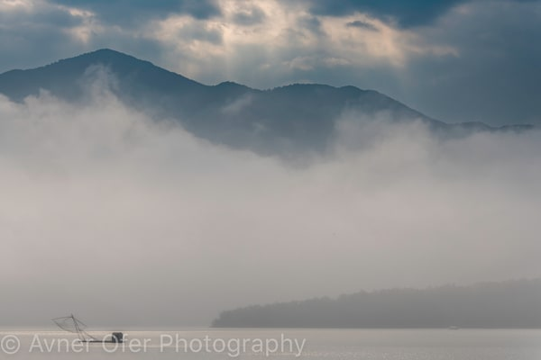 Traditional fishing net in the mist, Sun Moon Lake, Taiwan