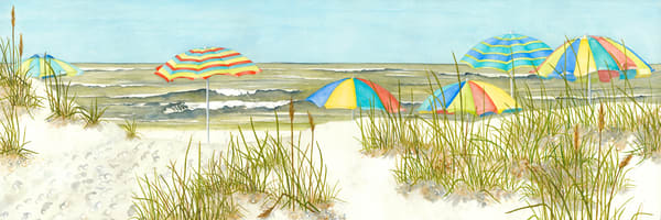 A print on gallery wrapped canvas by watercolor artist Sandra Galloway  of colorful umbrellas on the beach