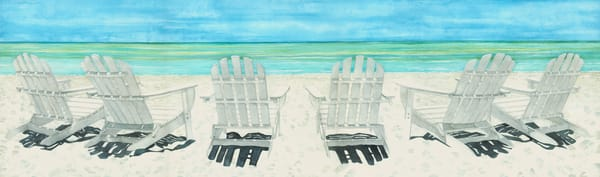 A print on gallery-wrapped canvas by watercolor artist Sandra Galloway of five white Adirondack chairs on the beach