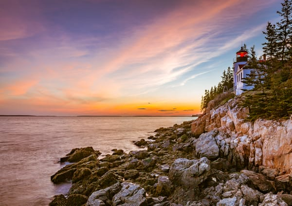 Fine Art Print of the moment of sunset at Bass Harbor Head Light in Acadia National Park, Maine.