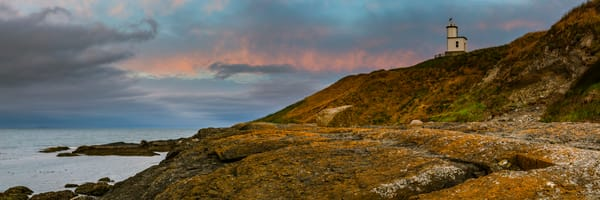 Fine Art Panoramic Print of Cattle Point Lighthouse during Sunrise on a cloudy summer morning in 2018