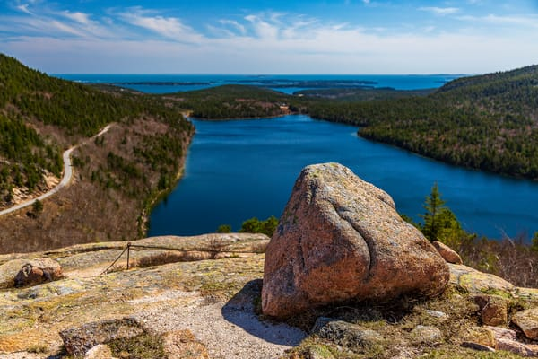 Fine Art Print featuring pink granite atop the Bubble Rock Overlook with Jordan Pond, the Cranberry Isles, and Atlantic Ocean as a backdrop.