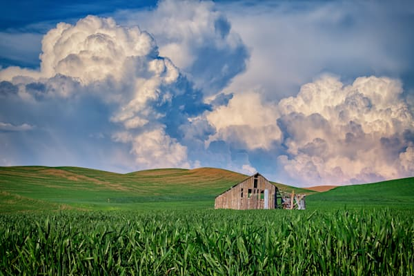 Old Barn Under Gathering Clouds by Rick Berk