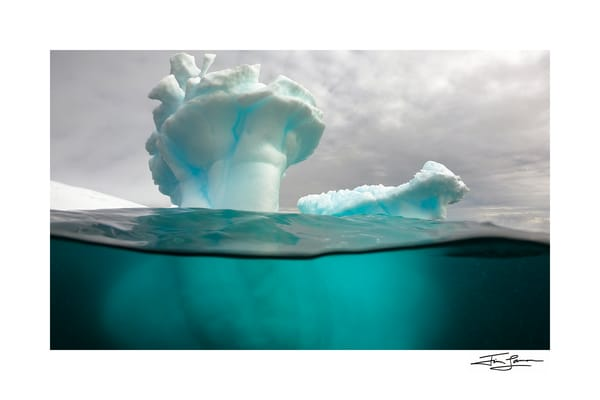 Photograph of a Sculpted Iceberg underwater.