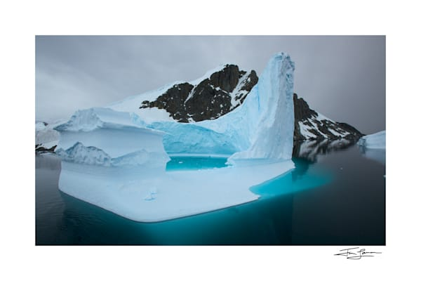 Photograph of a tall grounded iceberg, Antarctica.