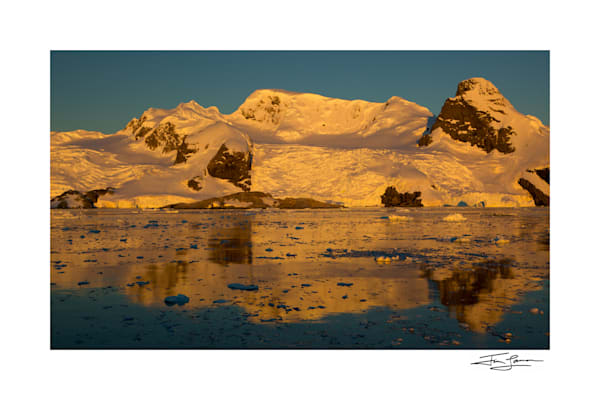 Sunset over mountains in Cierva Cove, Antarctica.