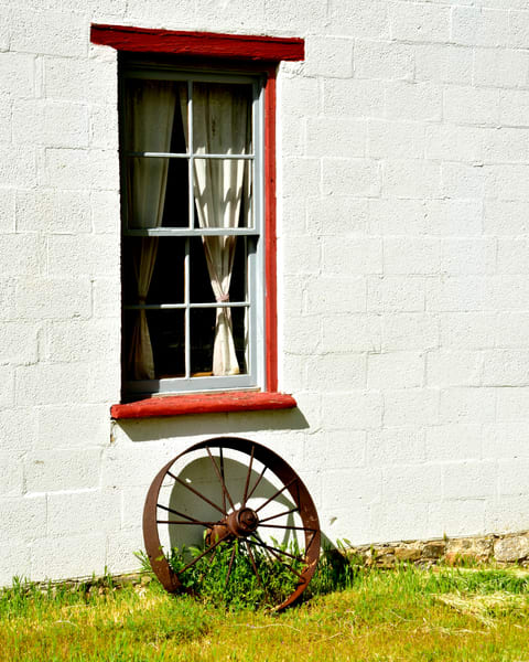 Red Framed Window and Wagon Wheel