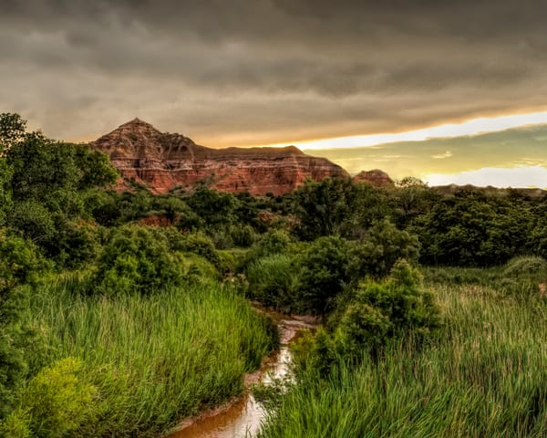 Rainy Sunset over Capital Peak, by Jim Livnigston