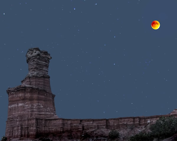 Blood Moon over the Lighthouse, by Jim Livnigston