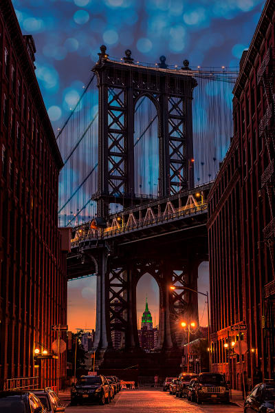 Manhattan Bridge under a decorative, twilight sky.
