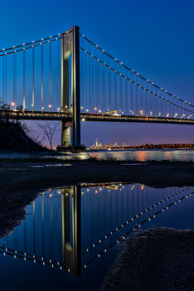 Verazzano Bridge reflecting in puddle