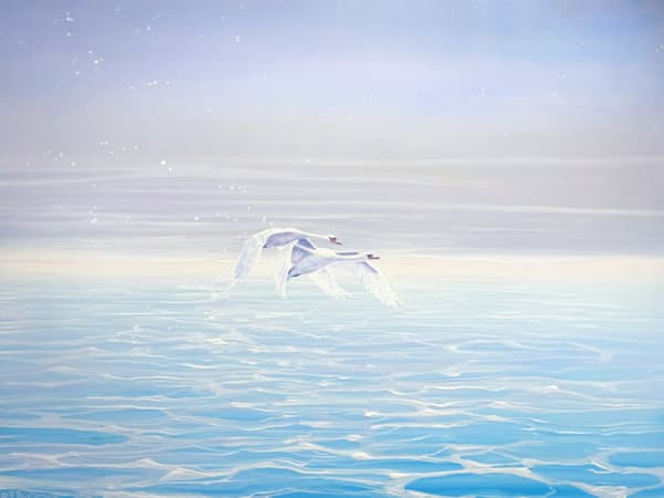 A small seascape oil painting on deep edge canvas of two swans in flight over blue sparkling water.