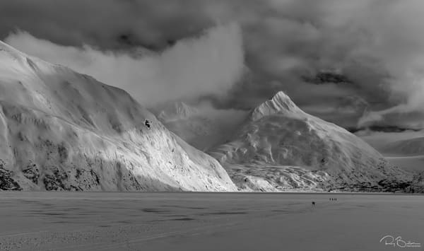 Hikers make the trek to Portage Glacier on Portage Lake in Southcentral Alaska. Winter. Afternoon.