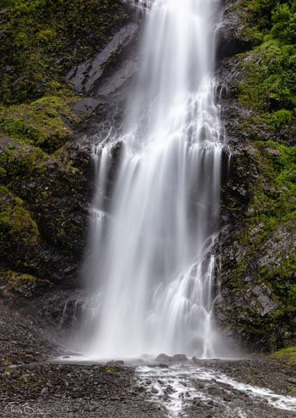 Long exposure of base of Bridal Veil Falls in Keystone Canyon near Valdez in Southcentral Alaska. Summer. Morning.