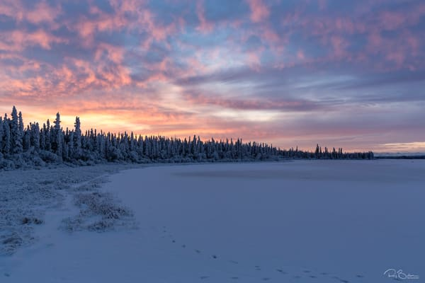Alpenglow and sunrise at Deadman Lake in Tetlin National Wildlife Refuge in Interior Alaska. Winter. Morning.