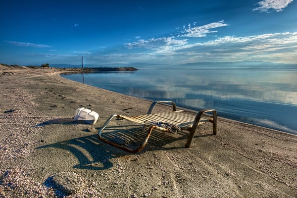 An abandoned lounge chair on the shore of the Salton Sea.