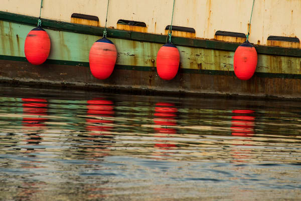 Red bouys on old boat