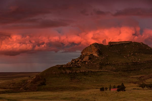 lone cabin in pink storm