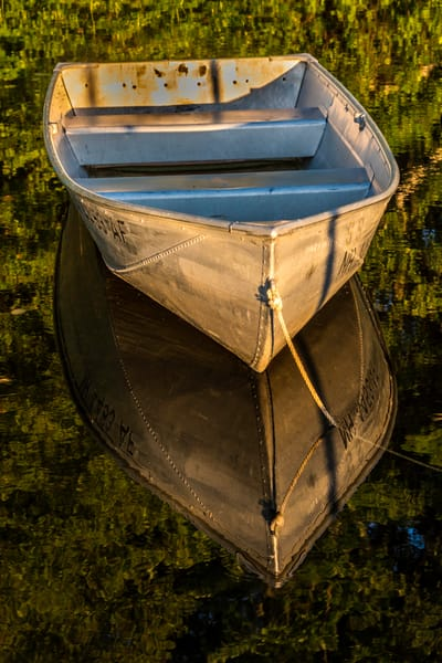Reflecting rowboat in warm light
