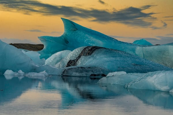 Orange and blue sunrise glacier