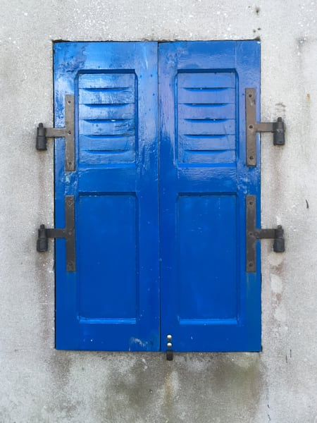 blue shutters black hinges