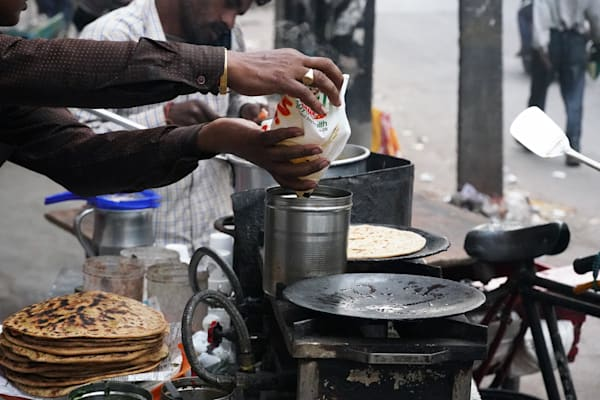 Masala Chai Tea being made on the streets of Old Delhi, India