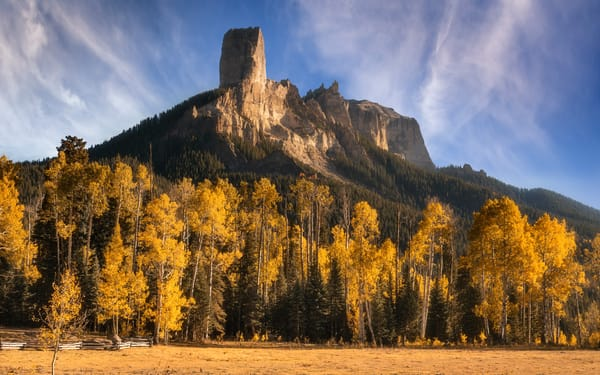 Chimney Rock Amidst Fall Foliage in Colorado's San Juan Mountains by fine art photographer Mike Taylor of Taylor Photography.