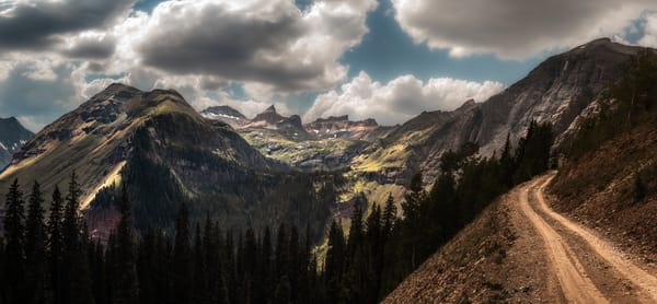 Heading Up to Clear Lake, a picturesque Colorado landscape with mountains, clouds and red rocks by fine art photographer Mike Taylor of Taylor Photography