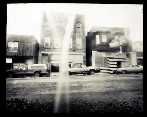 Bud's Tavern, Exterior  (paper negative, 8x10 pinhole camera from a sheet of cardboard, lens: bottom of broken liquor bottle)