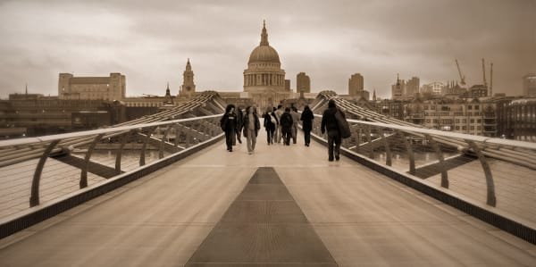 Millenium Bridge leading over The River Thames to St Paul's Cathedral, London, england