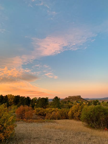 Vertical Photo of Castle Rock CO at Twilight, Fall Colors & Beautiful Skies