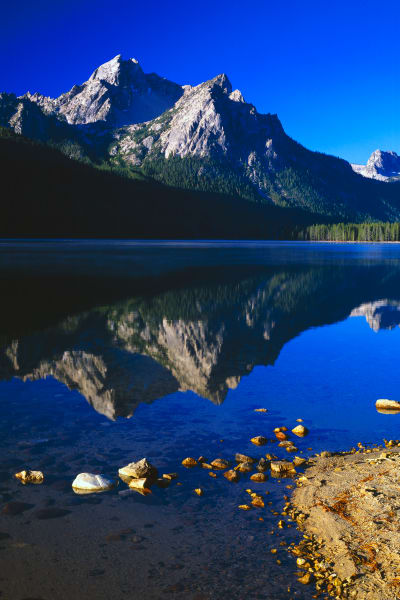 Mountain reflections in lake, Sawtooth National Forest.