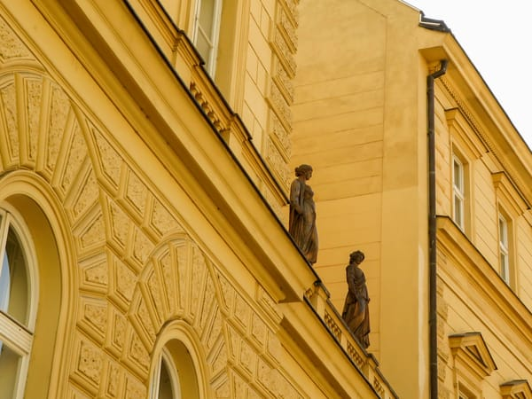 Two Statues On a Roof, Prague, Czechia