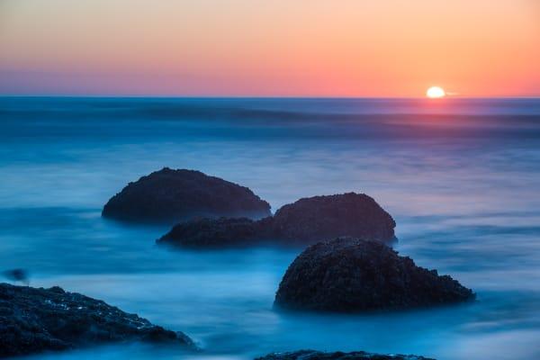 Sun Setting Over Horizon