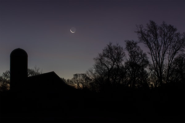 A crescent moon rises over Harlinsdale Farm
