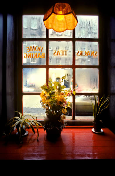 Tea Time On The Royal Mile in Edinburgh Scotland, from inside a tea room looking out the condensation filled window, wintry March day