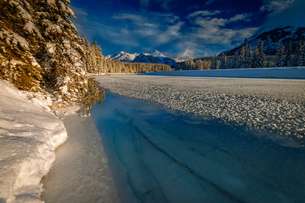 Winter sun on the river in Banff National Park. |Canadian Rockies|Rocky Mountains|