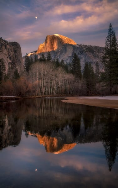 Winter Moonrise rises over the Half Dome in Yosemite