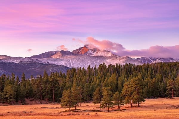 Sunrise photo of snow covered Longs Peak in Rocky Mountain National Park CO