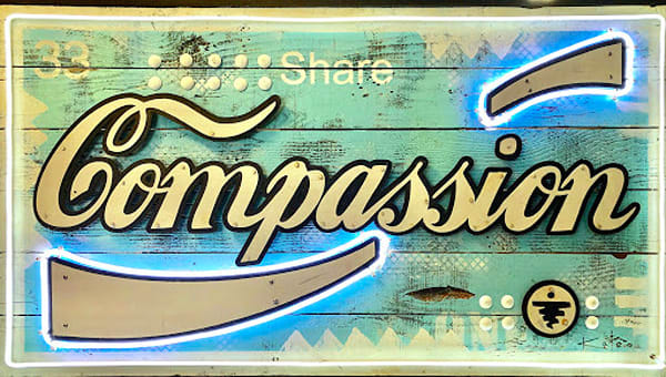 """Share Compassion"" Neon Sign Art on Distressed Wood"