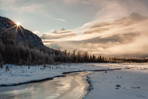 Sunrise on Eagle River valley and Polar Bear peak in Chugach State Park at Eagle River Nature Center in Southcentral Alaska. Winter. Morning.