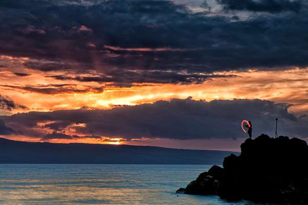 Fire Dancer at sunset, Black Rock, Maui