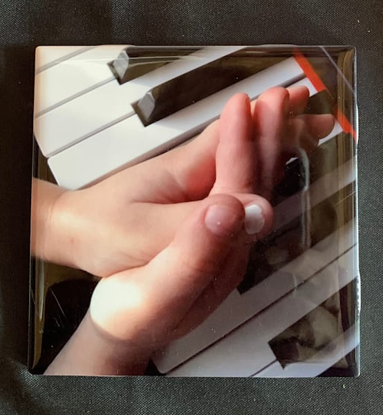 child's hands on a Piano
