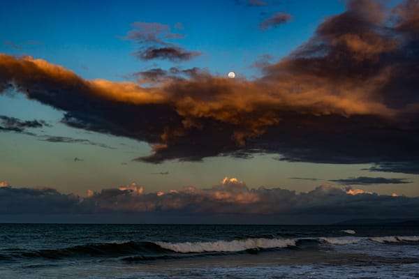 Full moon over orange rain clouds