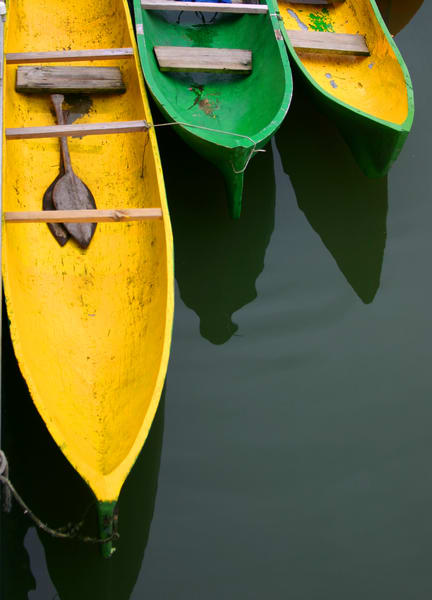 Dugout canoes image green yellow images for sale