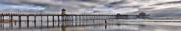 huntington beach pier panorama with woman walking
