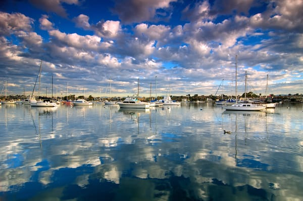 image of reflected clouds in newport bay, california